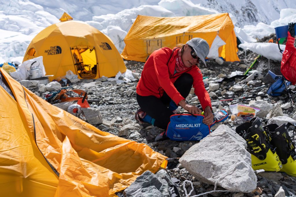 hilaree nelson looking through the mountaineer medical kit