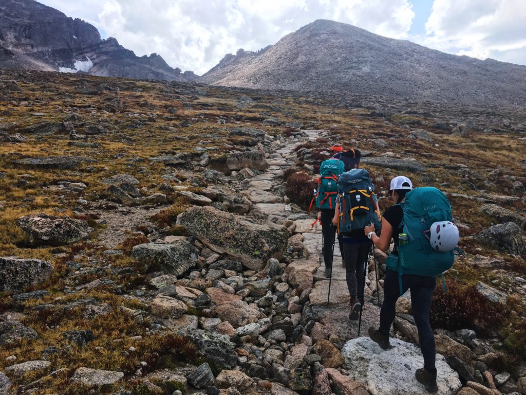 group hiking up steep slope
