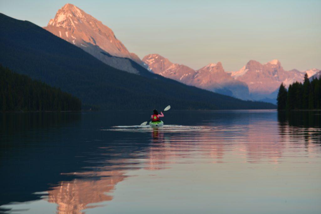 woman kayaking in mountains