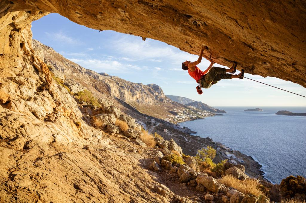 rock climbing by ocean