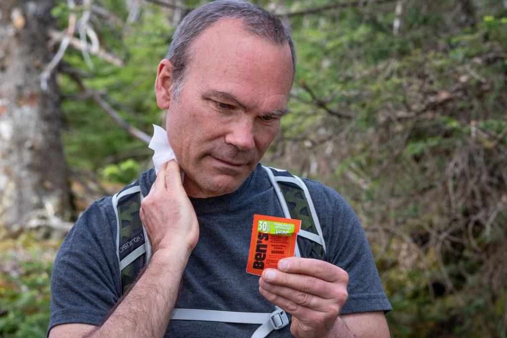 hiker apply Ben's 30 insect repellent wipes
